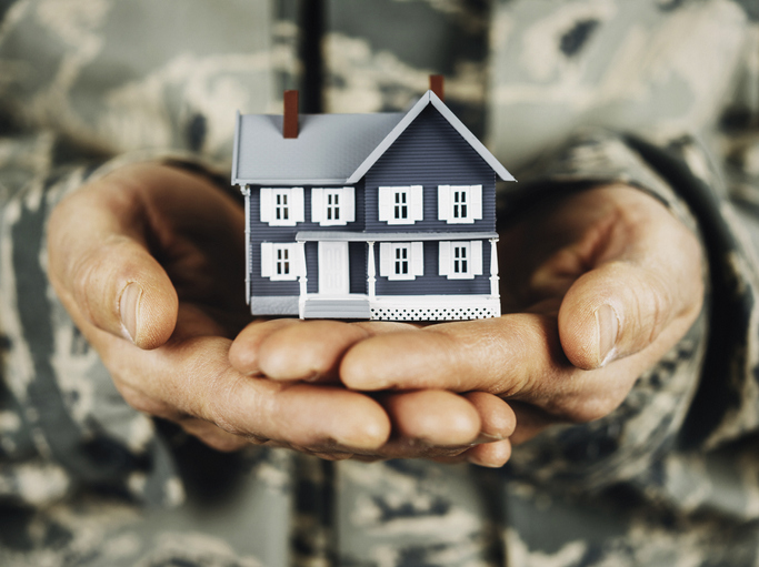 Soldier holding a miniature house