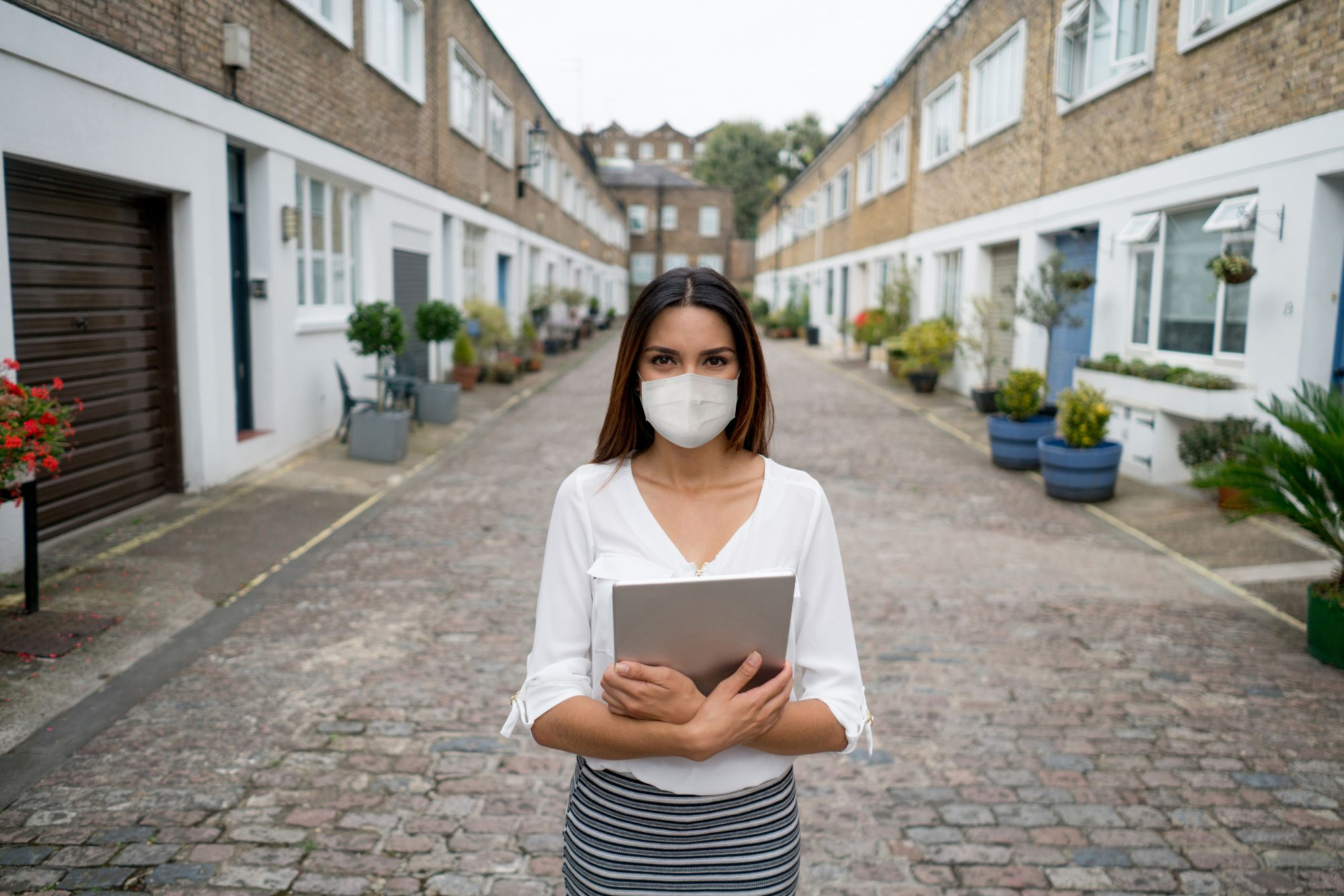 Portrait of a real estate agent wearing a facemask while showing houses during the COVID-19 pandemic - Loralee Wood | Las Vegas Realtor