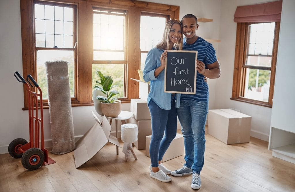 Couple smiling for getting their first home
