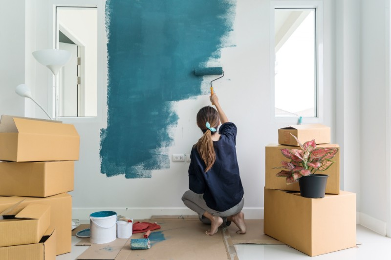 a woman staging her home before selling it