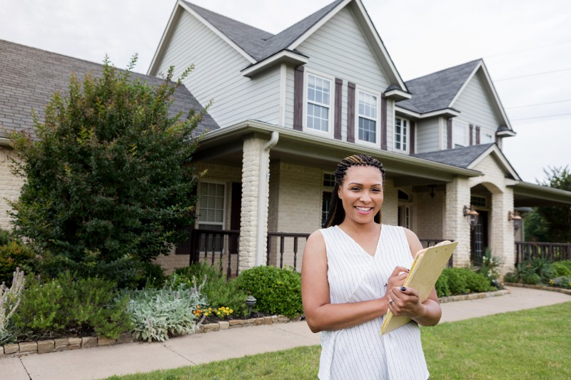 Home inspector in front of a house to be inspected