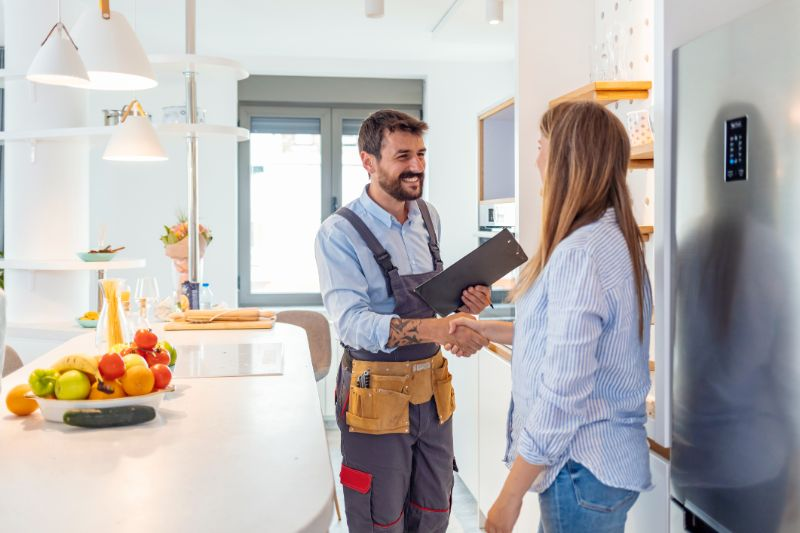 home inspector and the owner having shake hands
